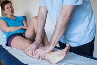book online plymouth - kieron giving a sports massage